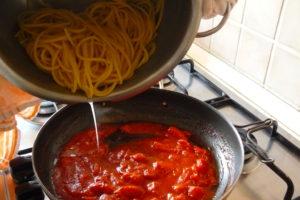 mix cooked spaghetti with the scarpariello tomato sauce